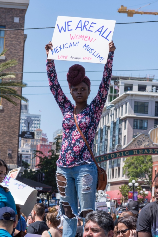 Afro American woman with sign at protest